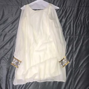 Cold shoulder beaded cream colored Bebe dress